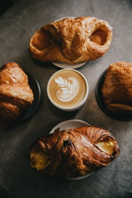 Fresh Pastries with Latte at Cafe